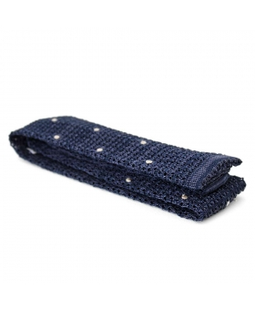 blue knitted tie with white polka dots